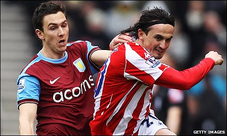 Stewart Downing tussles with Tuncay