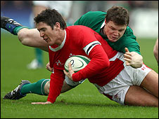 James Hook of Wales is tackled by Ireland's Brian O'Driscoll