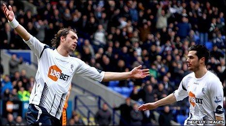 Johan Elmander (left) celebrates his goal