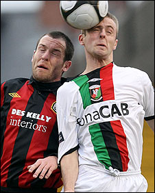 Mark Rossiter of Bohemians in action against Richard Clarke of Glentoran