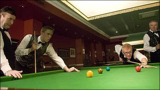 Chris Evans and Jonny Saunders playing snooker as Jimmy White and John Virgo look on
