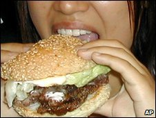 Girl eats a whale burger in Hakodate, northern Japan