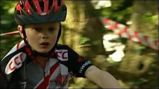 Boy on bike wearing helmet