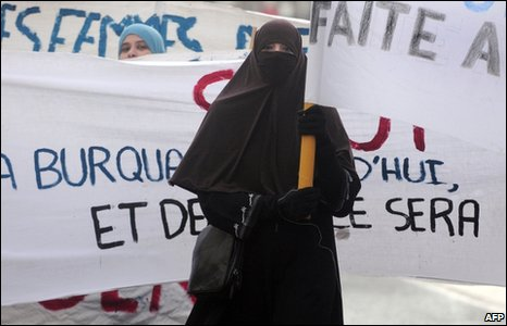 A woman wearing a niqab protests at poposals to ban face veils in France
