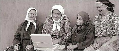 Villagers using a laptop