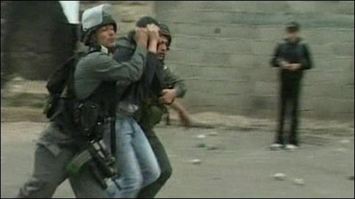 Israeli Police arresting a Palestinian