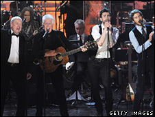 Allan Clarke and Graham Nash of the Hollies perform with Adam Levine and Jesse Carmichael of Maroon 5