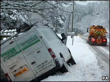Van that has gone off the road in snow in Berkshire in January