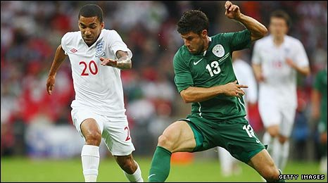 England winger Aaron Lennon in action against Slovenia
