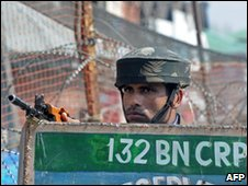 A Indian Central Reserve Police Force (CRPF) soldier stands alert after a shooting in Srinagar on March 16, 2010