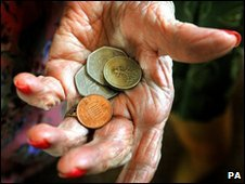 Loose change in hand