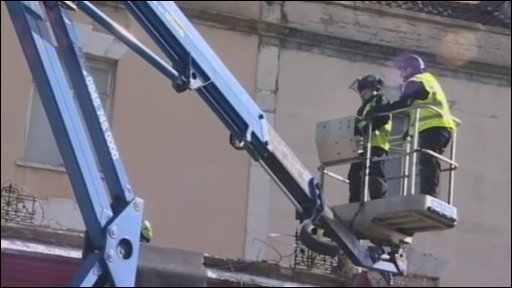Cherrypicker is used to reach protesters
