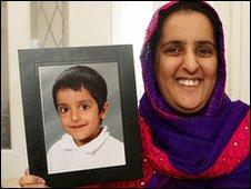 Akila Naqqash and a photograph of her son, Sahil Saeed