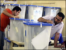 Electoral workers check ballot boxes in Baghdad (16 March 2010)