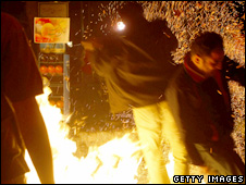 Men jump over bonfire in Tehran (photo from March 2008)