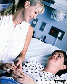 A woman visiting a friend in hospital