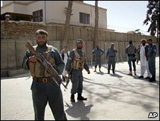Police outside the IRD office in Lashkar Gah. Photo: 17 March 2010