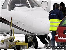Beckham's crutches are just visible as he boards the plane at Turku airport