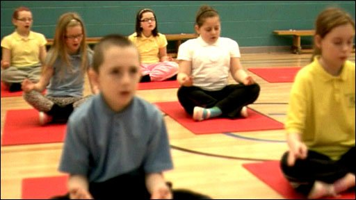 Children learn yoga at school