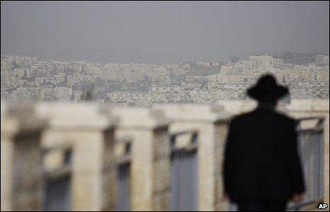 A Jewish man walks in the east Jerusalem neighbourhood of Ramat Shlomo, 10 March 2010 