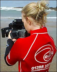 Louise Walter filming on the beach