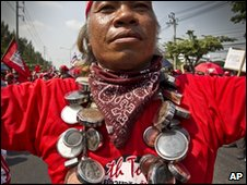 A Thai protester wears multiple amulets on 15 March 2010