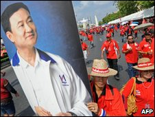 Protesters carry a poster of ousted leader Thaksin Shinawatra on 14 March 2010