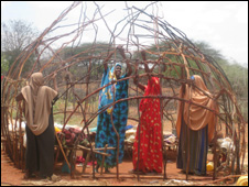 Women building news houses in Kenya