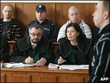 The three men (left, second right, and right) in the Krakow court on 18 March 2010