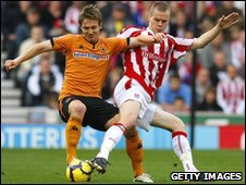Ryan Shawcross (right) tackles Wolves' Kevin Doyle