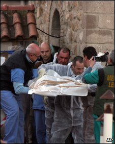 The remains found are brought out of the Most Holy Trinity church on Wednesday