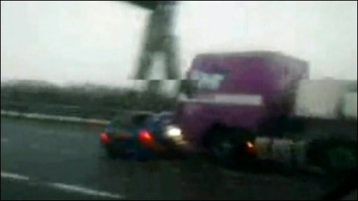 Car pushed by lorry