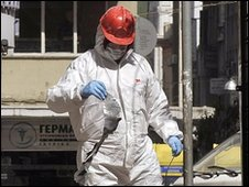 A Greek official at the scene of a bomb attack in central Athens, 19 March 2010