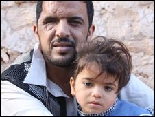 An injured man, Abdul Abdul Asada and daughter