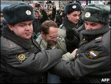 Russian police arrest an opposition protester in Moscow