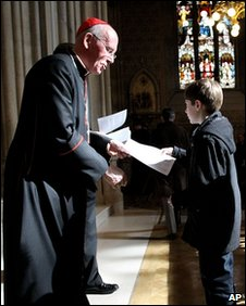 Cardinal Sean Brady hands a copy of the Pope's letter to a churchgoer in Northern Ireland