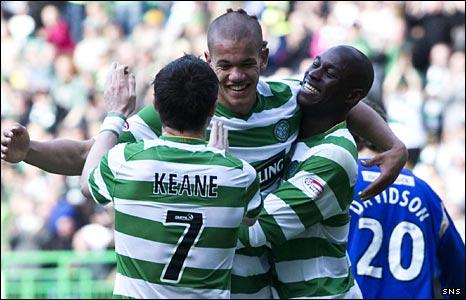 Robbie Keane, Josh Thompson and Marc-Antoine Fortune celebrate