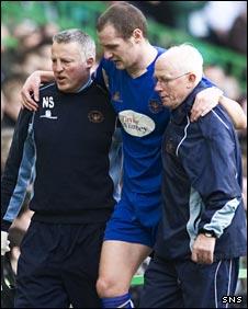 St Johnstone striker Kenny Deuchar is helped from the field