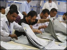 Election officials count votes in Baghdad