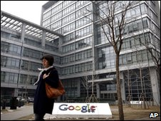 A woman walks past Google China headquarters in Beijing, Thursday, March 18, 2010.