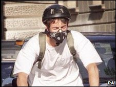Cyclist in London wearing an air pollution mask