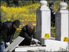 Police officers at the scene of the graves of two Cyprus Archbishops at a cemetery in capital Nicosia