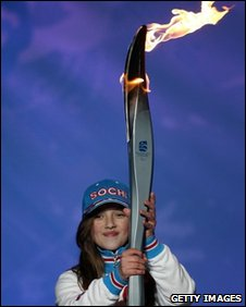 Sochi representative with torch