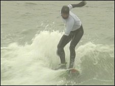 Surfer at contest in Boscombe