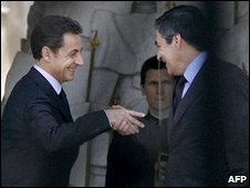 French Prime Minister Francois Fillon (R) shakes hands with French President Nicolas Sarkozy (L) after a meeting at the Elysee palace 22 March, 2010