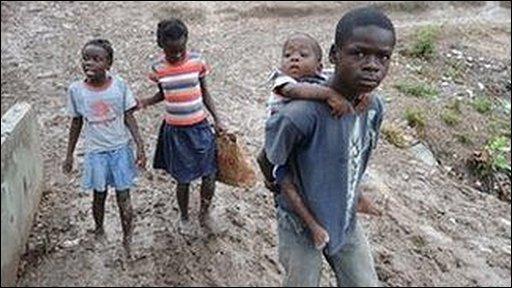 Kids walking through the mud in Haiti