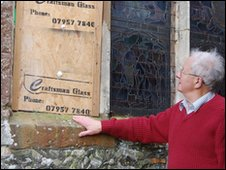 Eddie Knight outside the smashed window at St Peter's church in Copdock