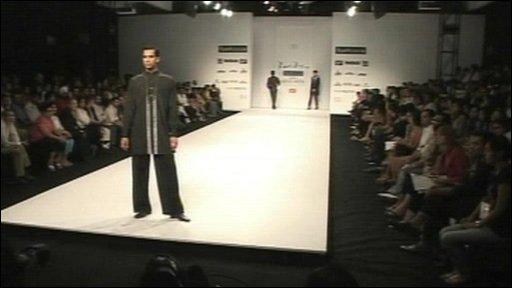 Male model on catwalk