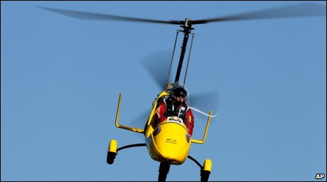 Norman Surplus takes off from the coastal town of Larne, Northern Ireland, Monday March 22, 2010 to make the first round-the-world trip in a customized rotorcraft known as an autogyro