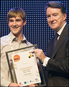 Tom is presented with his award from Business Secretary Lord Mandelson